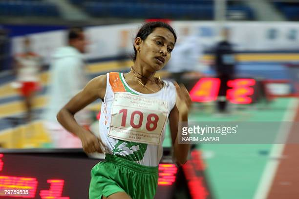 Sinimol Paulose of India leads the 1500m race during the Asian athletics indoor games at the Aspire Academy of Sports in the Qatari capital Doha on...