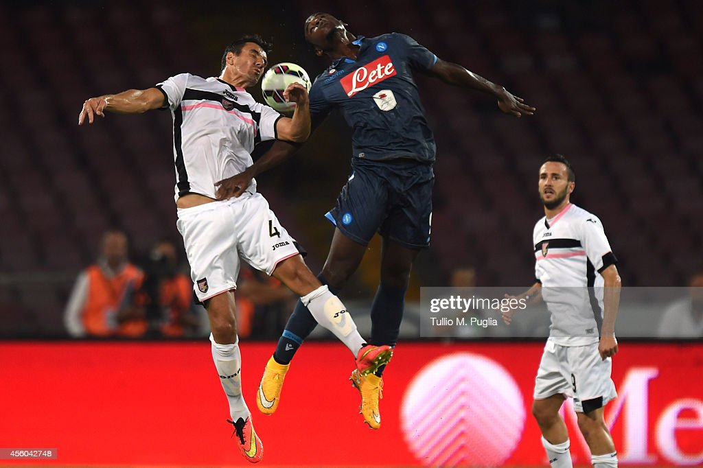 Sinisa Andelkovic (L) of Palermo and Duvan Esteban Zapata of Napoli jump for a header during the Serie A match between SSC Napoli and US Citta di Palermo at Stadio San Paolo on September 24, 2014 in Naples, Italy.