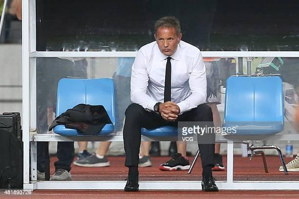 Sinisa Mihajlovic head coach of AC Milan looks on during the International Champions Cup match between AC Milan and Inter Milan at Longgang Sports...