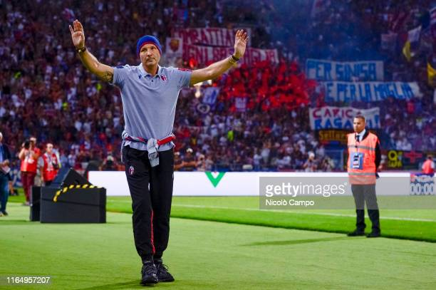 Sinisa Mihajlovic head coach of Bologna FC gestures as fans of Bologna FC show a banner for him prior to the Serie A football match between Bologna...