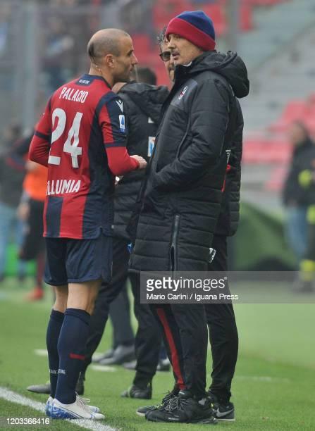 Sinisa Mihajlovic head coach of Bologna FC talks to Rodrigo Palacio of Bologna FC during the Serie A match between Bologna FC and Brescia Calcio at...