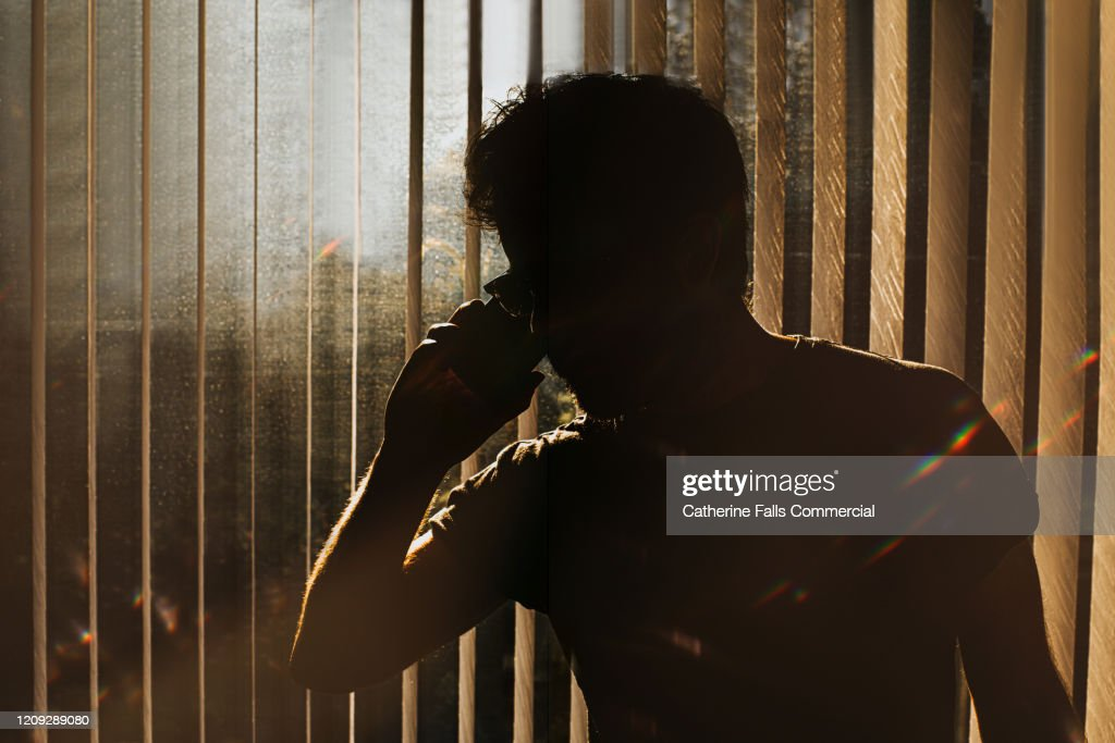 Sinister man on Phone : Stock Photo