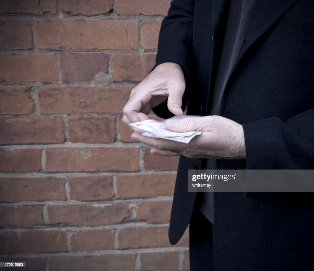 Sinister transaction : Stock Photo