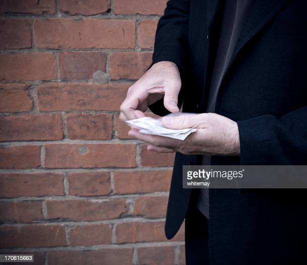 sinister transaction - bootlegger stock pictures, royalty-free photos & images