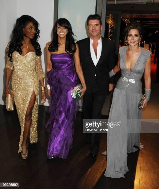 Sinitta a guest Simon Cowell and Cheryl Cole arrive at the National Television Awards at the O2 Arena on January 20 2010 in London England