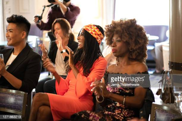 """Sinitta and Heather Small applaud the Cast and Crew panel during the """"Henpire"""" podcast launch event at Langham Hotel on September 10, 2020 in London,..."""
