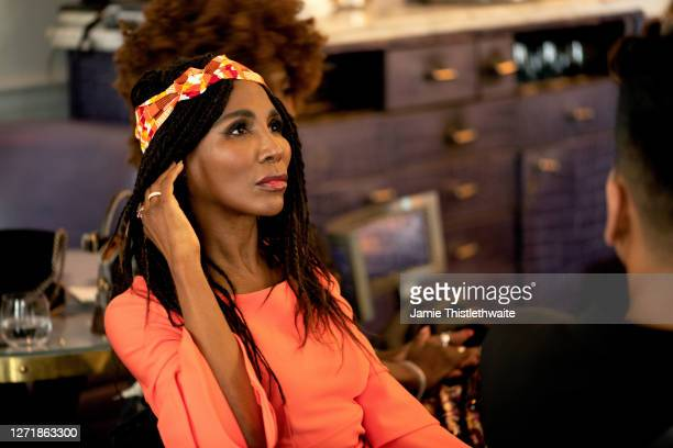 """Sinitta listens to the pCast and Crew panel during the """"Henpire"""" podcast launch event at Langham Hotel on September 10, 2020 in London, England."""