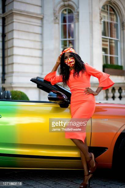 """Sinitta poses with the rainbow Bentley during the """"Henpire"""" podcast launch event at Langham Hotel on September 10, 2020 in London, England."""