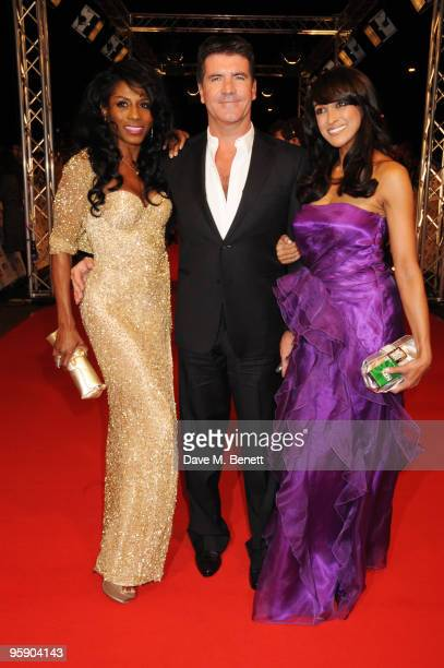 Sinitta Simon Cowell and a guest arrive at the National Television Awards at the O2 Arena on January 20 2010 in London England