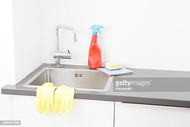 Sink and cleaning utensils in kitchen