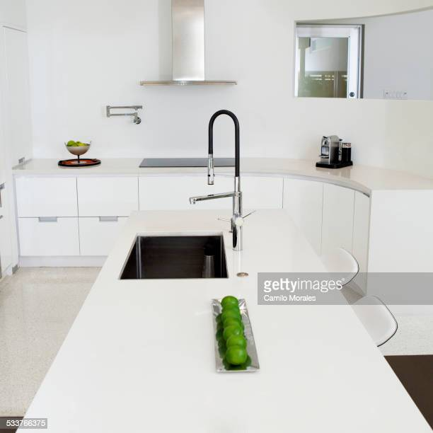 Sink, counter and stove in modern kitchen