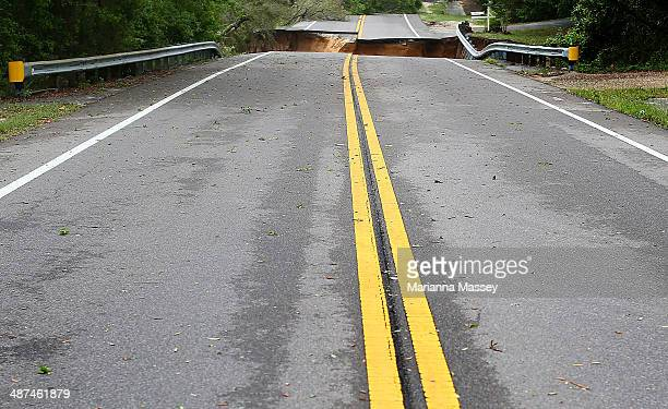 A sinkhole on Scenic Highway after part of the highway collapsed following heavy rains and flash flooding on April 30 2014 in Pensacola Florida A...