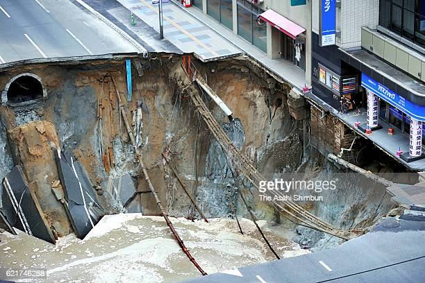 A sinkhole opens up in front of JR Hakata Station on November 8 2016 in Fukuoka Japan The sinkhole was 30 meters long 30 meters wide and 15 meters...