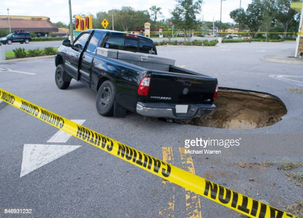 sinkhole swallows a car in florida - florida sinkhole stock photos and pictures