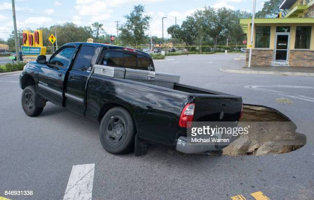 sinkhole swallows a car in florida - sinkhole stock photos and pictures