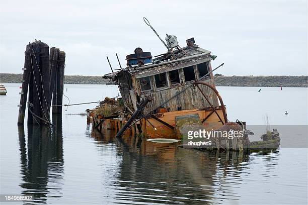 Sinking and decaying boat in Gold Beach Oregon Harbor
