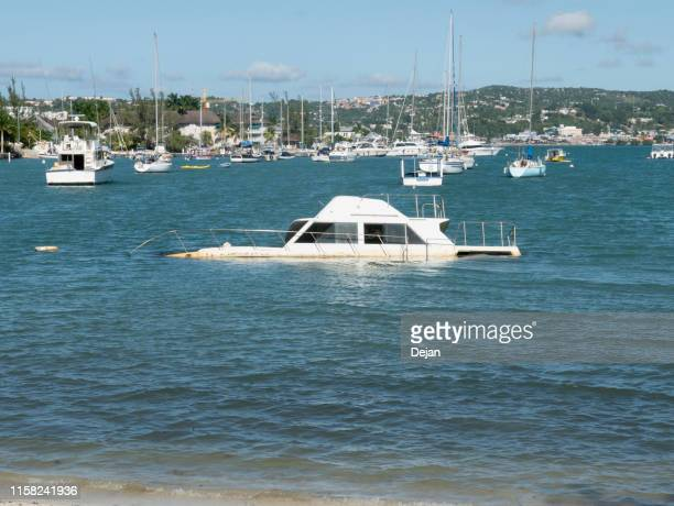 sinking boat in sunny montego bay, jamaica - sinking stock pictures, royalty-free photos & images