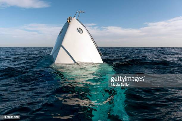 sinking boat - sinking stock pictures, royalty-free photos & images