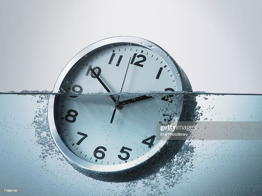 sinking clock : Stock Photo