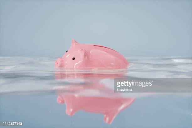 sinking piggy bank - crisis stock pictures, royalty-free photos & images