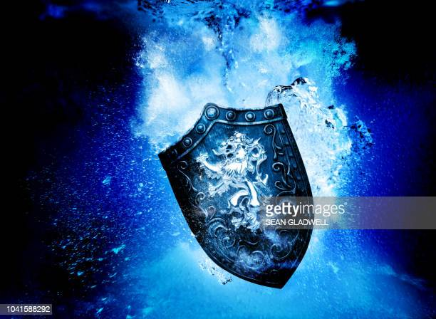 sinking shield underwater - guarding stock photos and pictures