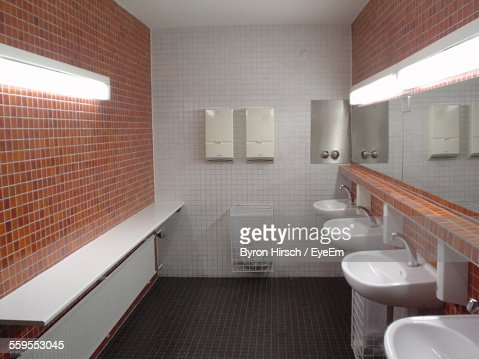 Sinks And Mirror In Public Restroom Stock Photo