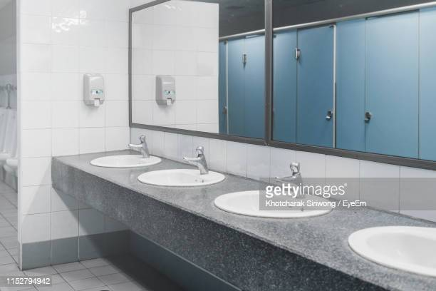 sinks in public restroom - public toilet stock pictures, royalty-free photos & images
