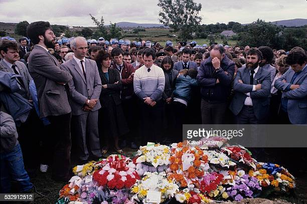 Sinn Fein leader Gerry Adams addresses the crowd in the funeral of an IRA volunteer as officers of the Garda look on Buncrana County Donegal Eire...
