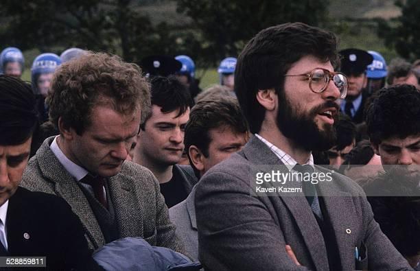 Sinn Fein leader Gerry Adams and Sinn Fein deputy leader and alleged IRA chief of staff Martin McGuinness attend the funeral of an IRA volunteer as...