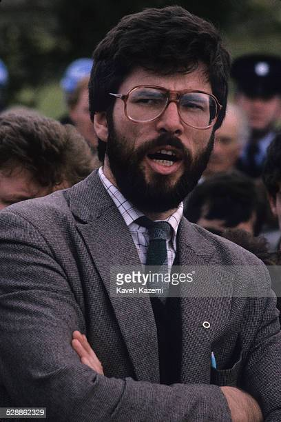 Sinn Fein leader Gerry Adams attends the funeral of an IRA volunteer as officers of the Garda look on Buncrana County Donegal Eire 20th September...