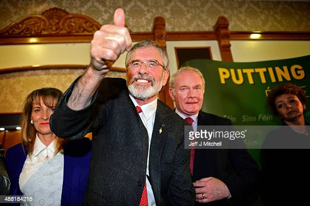 Sinn Fein Leader Gerry Adams gestures following a press conference at Balmoral Hotel after he was released from Antrim PSNI Station without charge...