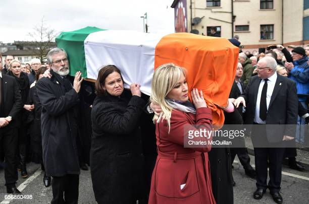 Sinn Fein leader Gerry Adams , Sinn Fein southern leader Mary Lou McDonald and Sinn Fein northern leader Michelle O'Neill carry the coffin of the...