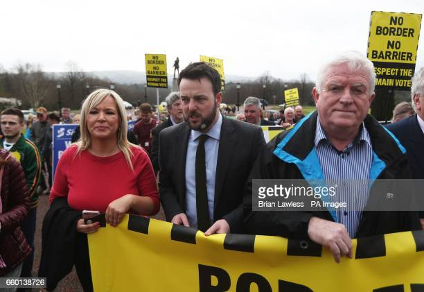 Sinn Fein leader in Northern Ireland Michelle O'Neill and SDLP leader Colum Eastwood take part in an Anti-Brexit protest outside Stormont in Belfast,...