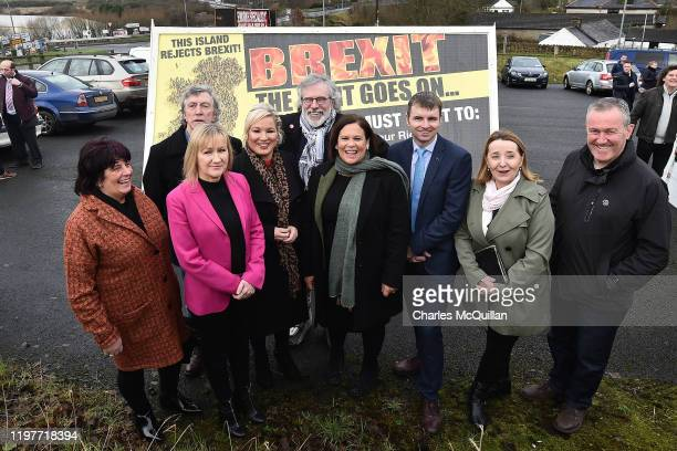 Sinn Fein leader Mary Lou McDonald and deputy leader Michelle ONeill pose for a photograph alongside former leader Gerry Adams among others at the...