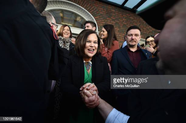 Sinn Fein leader Mary Lou McDonald is congratulated by supporters and fellow elected TDs as she arrives for the reconvening of the 33rd Dail Eireann...