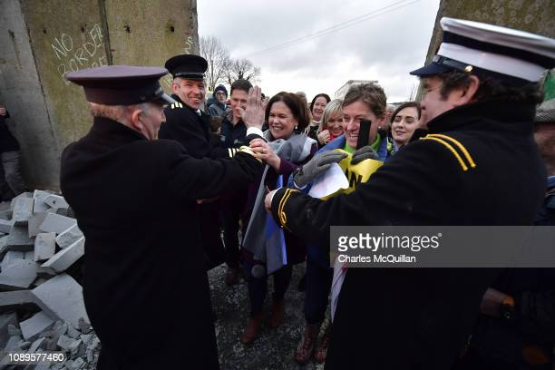 Sinn Fein leader Mary Lou McDonald is stopped by members of the Border Communities Against Brexit group as they take part in a mock border wall and...
