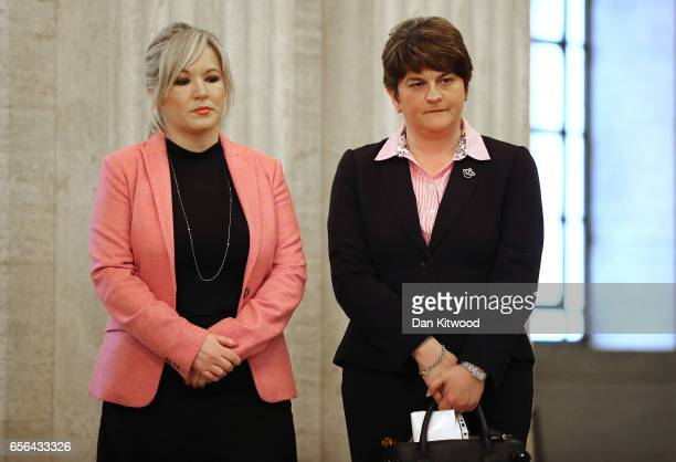 Sinn Fein leader Michelle O'Neill and Democratic Union Party Leader Arlene Foster wait to sign a book of condolence at Stormont on March 22, 2017 in...