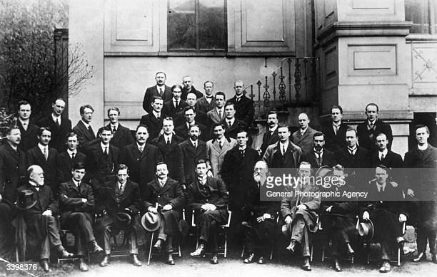 Sinn Fein leaders at the First Dail Eireann Thirtysix elected members were in jail Left to right Front row L Ginnell Michael Collins Cathal Brugha...