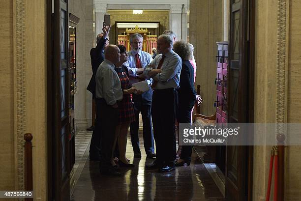 Sinn Fein members including Gerry Adams and Martin McGuinness gather together before a press conference at Stormont on September 10 2015 in Belfast...