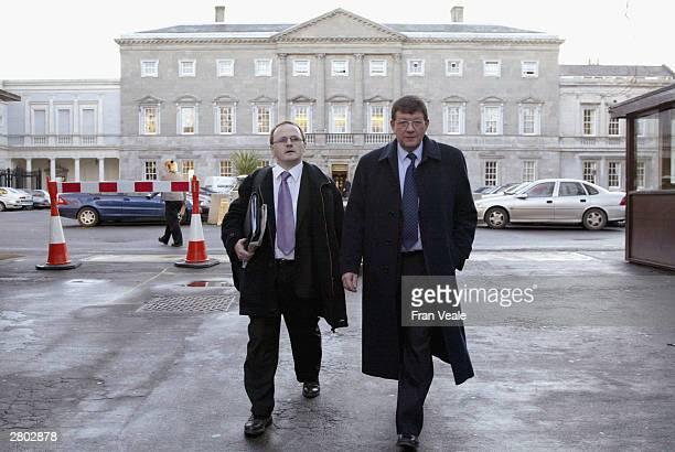 Sinn Fein MLA Barry McElduff and Sinn Fein Vice President Pat Doherty arrive at Leinster House on December 11 2003 in Dublin Ireland The group aims...
