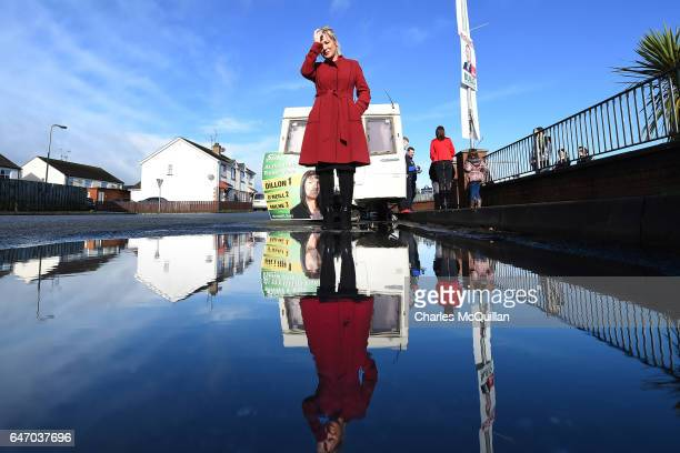 Sinn Fein northern leader Michelle O'Neill pictured standing outside a Sinn Fein election caravan parked outside Clonoe polling station as she casts...