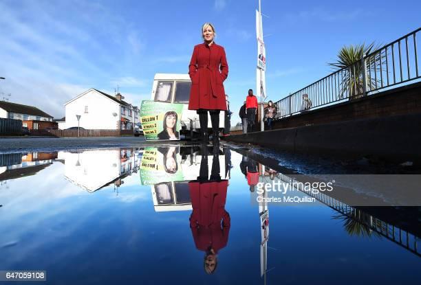 Sinn Fein northern leader Michelle O'Neill poses for photographers outside a Sinn Fein election caravan parked outside Clonoe polling station as she...