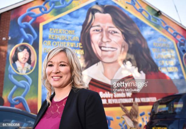 Sinn Fein northern leader Michelle O'Neill stands in front a mural of republican hunger striker Bobby Sands after holding a post election press...