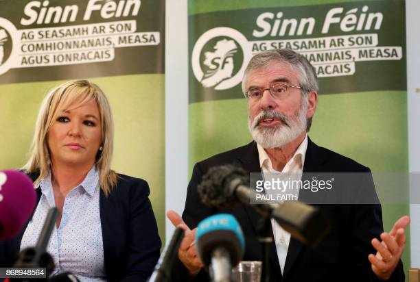 Sinn Fein President Gerry Adams accompanied by Northern Leader of Sinn Fein Michelle O'Neill speaks at a press conference at Stormont in Belfast on...