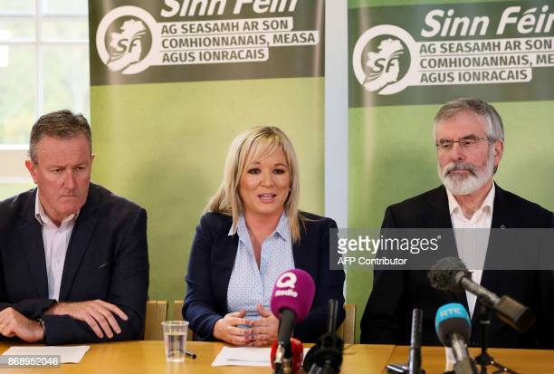 Sinn Fein President Gerry Adams and Sinn Fein Negotiator Conor Murphy look on as Northern Leader of Sinn Fein Michelle O'Neill speaks at a press...