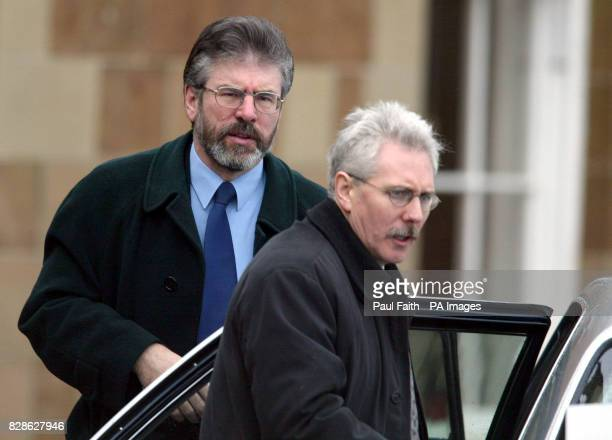 Sinn Fein President Gerry Adams arrives with his press secretary Richard McAuley outside Hillsborough Castle County Down Belfast on the second day of...