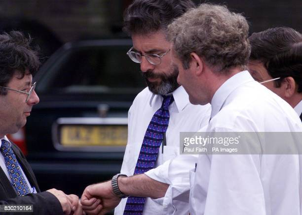 Sinn Fein President Gerry Adams checks his watch as six o'clock arrives at Castle Buildings, Stormont in Belfast with still no sign of agreement on...