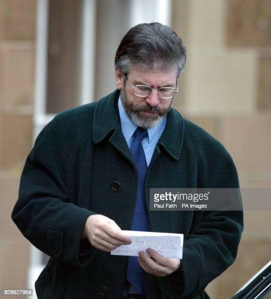 Sinn Fein President Gerry Adams checks some paperwork on arrival at Hillsborough Castle County Down Belfast where the Peace Process talks resume *...