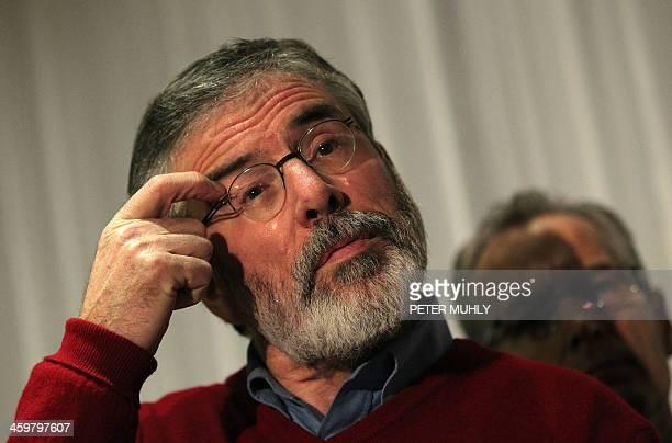 Sinn Fein President Gerry Adams gestures as he speaks to the media after former US diplomat Richard Haass and co-chair Prof Meghan O'Sullivan failed...