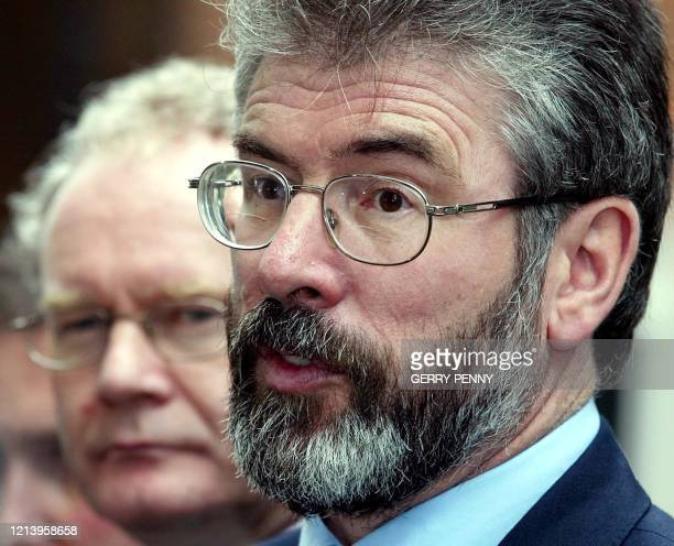 Sinn Fein President Gerry Adams gives a press conference outside N° 10 Downing Street along side his deputy Martin McGuinness 10 October 2002 after...